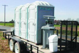 This set of port-a-johns on a trailer can be easily moved to be accessible to workers.