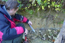 A volunteer measures between bank pins (Photo by: Jim Walter, Master Watershed Steward)