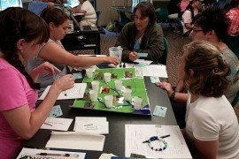 "Educators use the ""Watershed Decisions"" activity at a training workshop (Photo: Susan Boser, Penn State)"