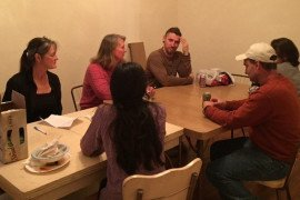 Study circle participants share experiences around the dinner table.